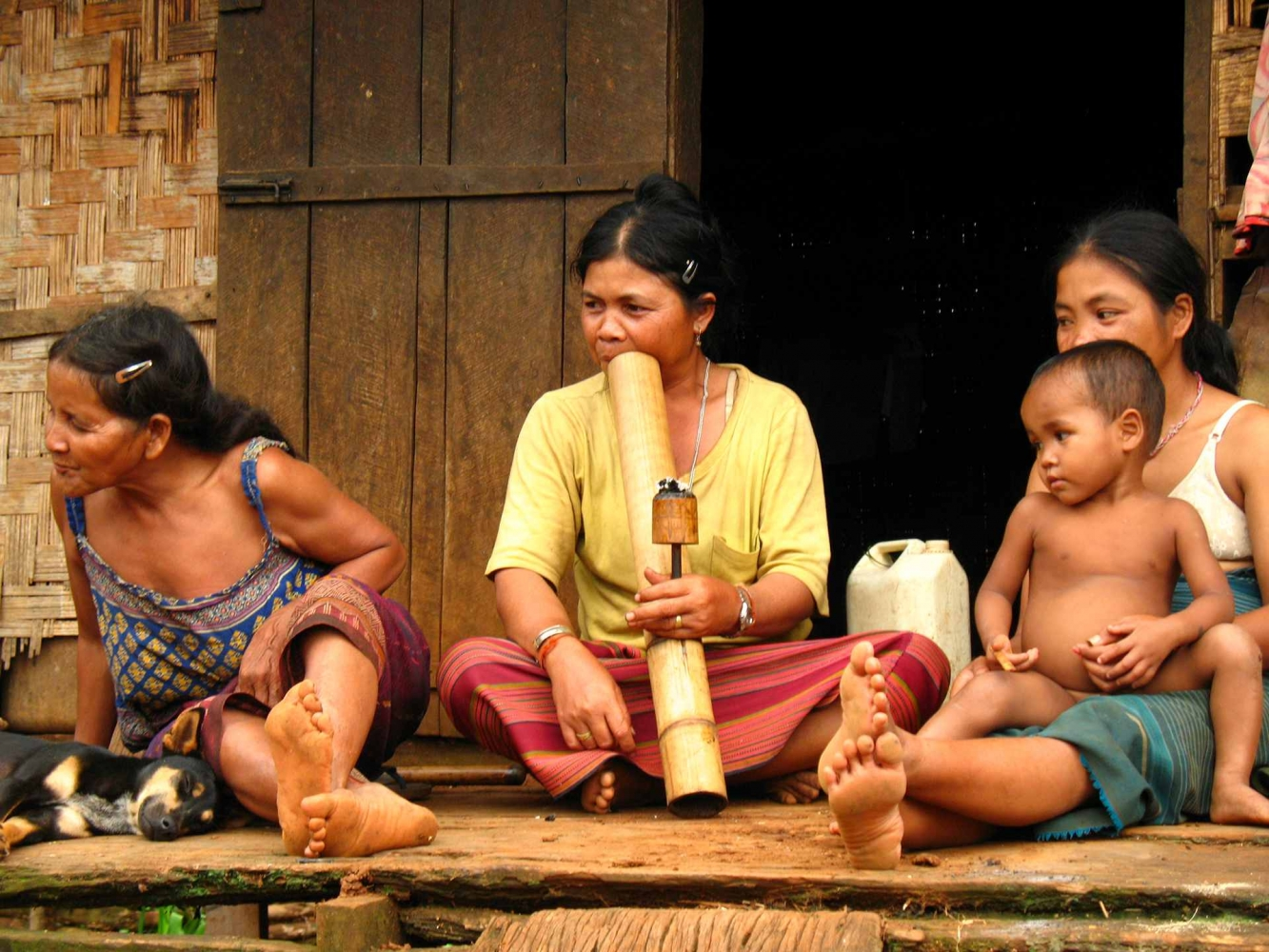 Lao women in traditional village house