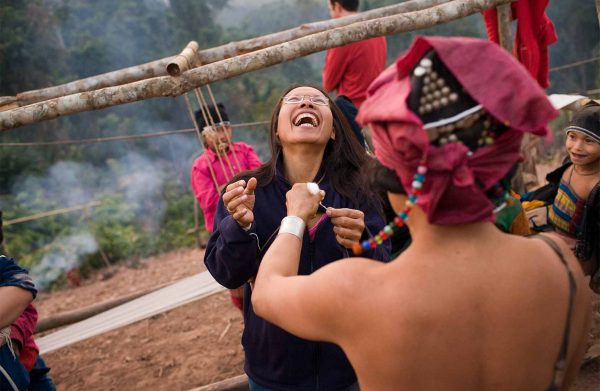 a tourist enjoy time on tour with Akha people