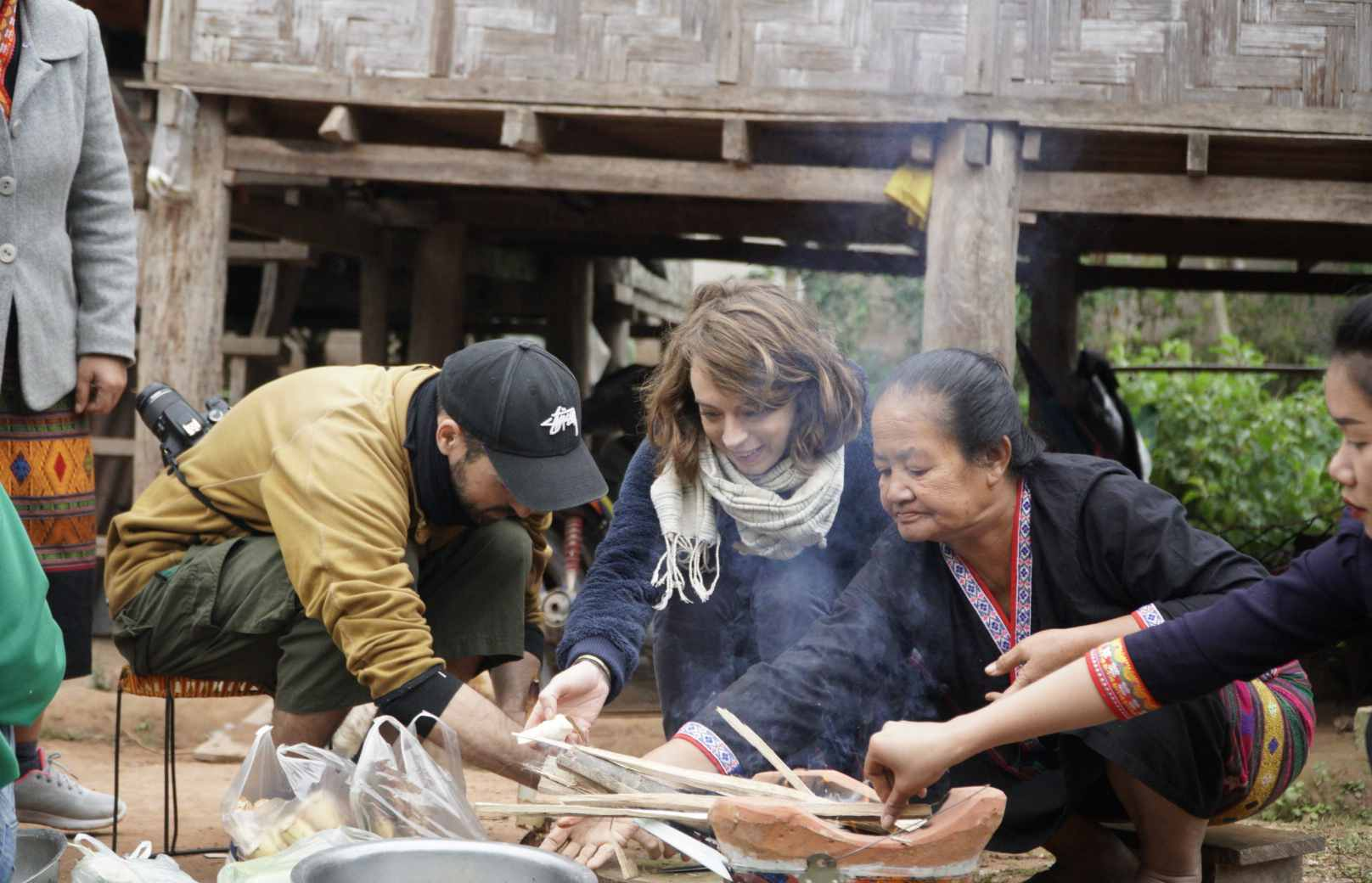 tourists cooking with village local people, rustic cooking classes